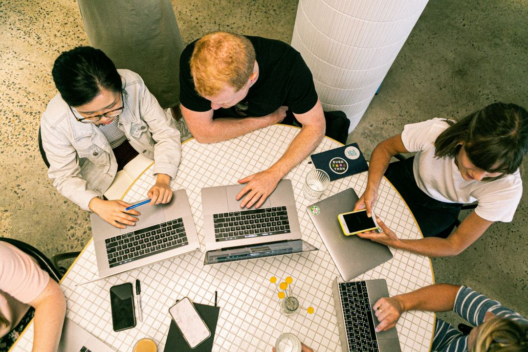 a group of people collaborate at a table